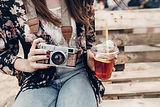 stylish-hipster-woman-holding-old-photo-