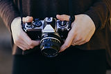 250982-a-person-holding-a-camera_lets-ma