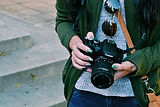 woman-holding-black-canon-dslr-camera.jp