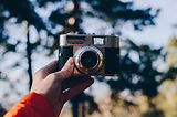 248869-a-person-holding-a-35mm-camera-in