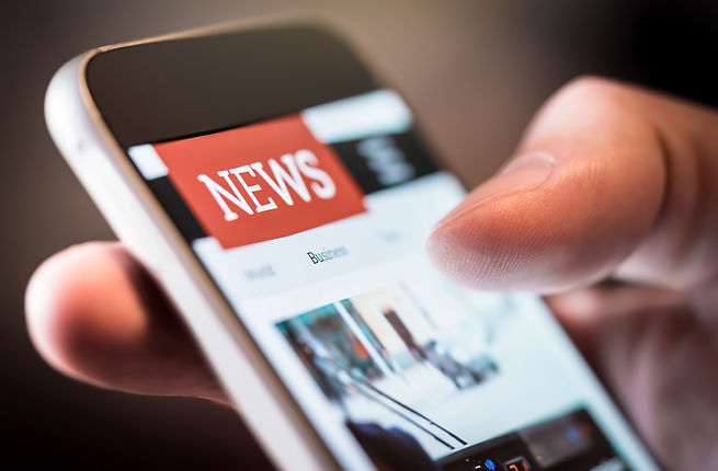 Online news in mobile phone. Close up of smartphone screen. Man reading articles in applic