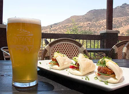 Oak Park lunch of Pork Bao Buns and craft beer on the outdoor patio.