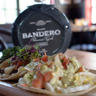 Two tacos and a bottle of Bandero tequila.