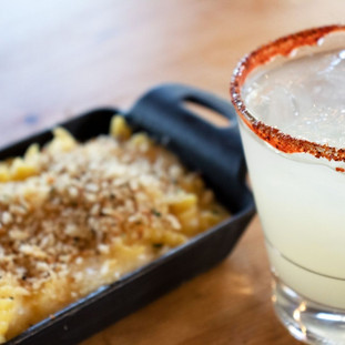 Max and cheese next to a cucumber jalapeno margarita.
