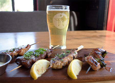 Agoura Hills happy hour pint of beer and 4 skewers of meat.