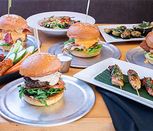 An Assortment of Our Burgers, Sandwiches, Salads, Sides and Robata Skewers