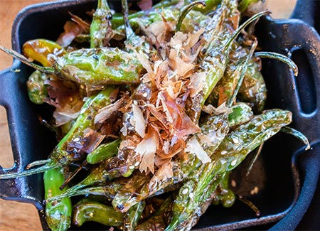 Tavern Tomoko serving shishito peppers dish for happy hour in Agoura Hills.