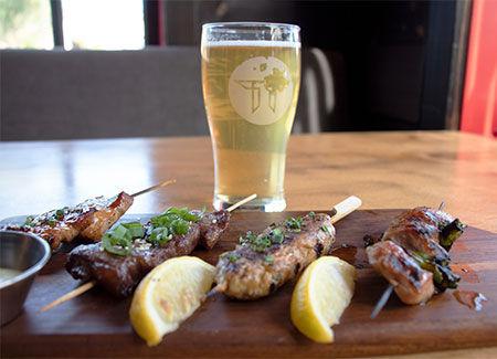 Oak Park bar serving beer and Robata skewers during Happy Hour.