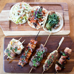 Five meat skewers and three tacos.