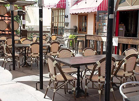Tables and chairs on our outdoor patio where patrons enjoy the best lunch near Forest Cove Park, Agoura Hills.