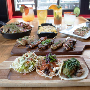 Tacos Trio, Protein Sampler, mixed drinks and three food dishes.