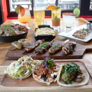 Three tasty tacos, four skewers, three food dishes and four drinks.