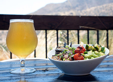 Kanan Rd bar serving food and beer on outdoor patio.
