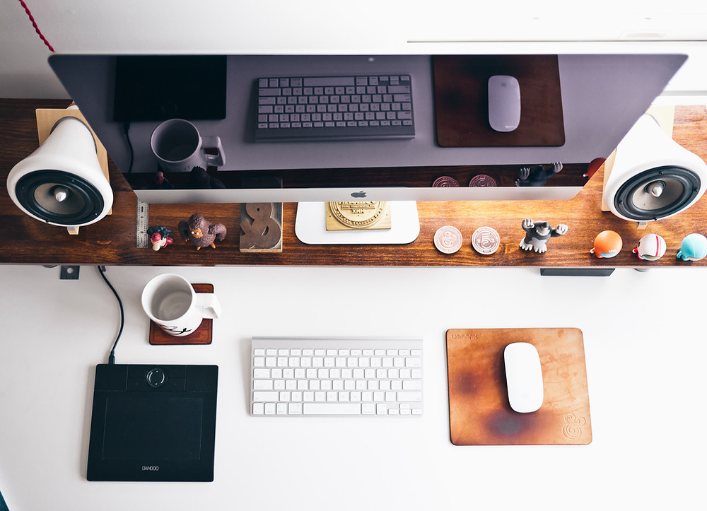 Tidy office desk with keyboard and trinkets