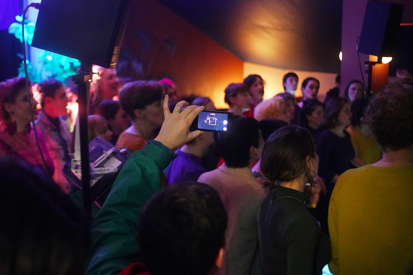 Closeup of audience watching and filming