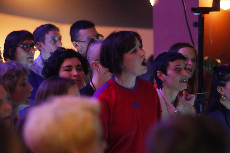 A close up of a crowd of choir members p