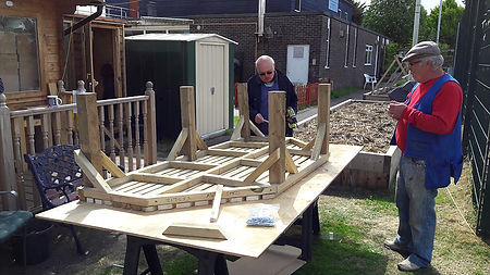 Copnor Men's Shed working on bench