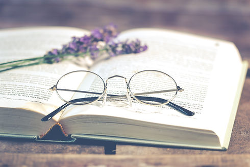 silver-colored-framed-eyeglasses-on-open
