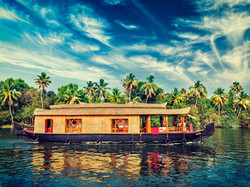 Travel tourism Kerala background - vintage retro effect filtered hipster style image of houseboat on