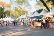 Blurred image of people in day market fe