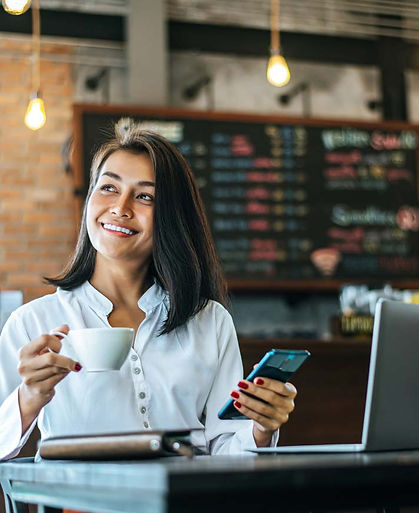 woman-sitting-happily-working-with-smart