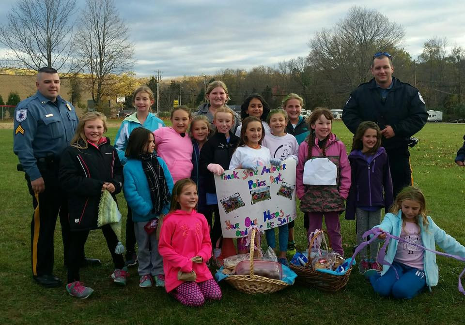 Andover Girls on the Run decided as a team, to show their support to our department as a part of their Community Impact Project. After they ran a practice 5k they presented Sgt. Kithcart and Officer Puccio with delicious baskets of home made baked goods!