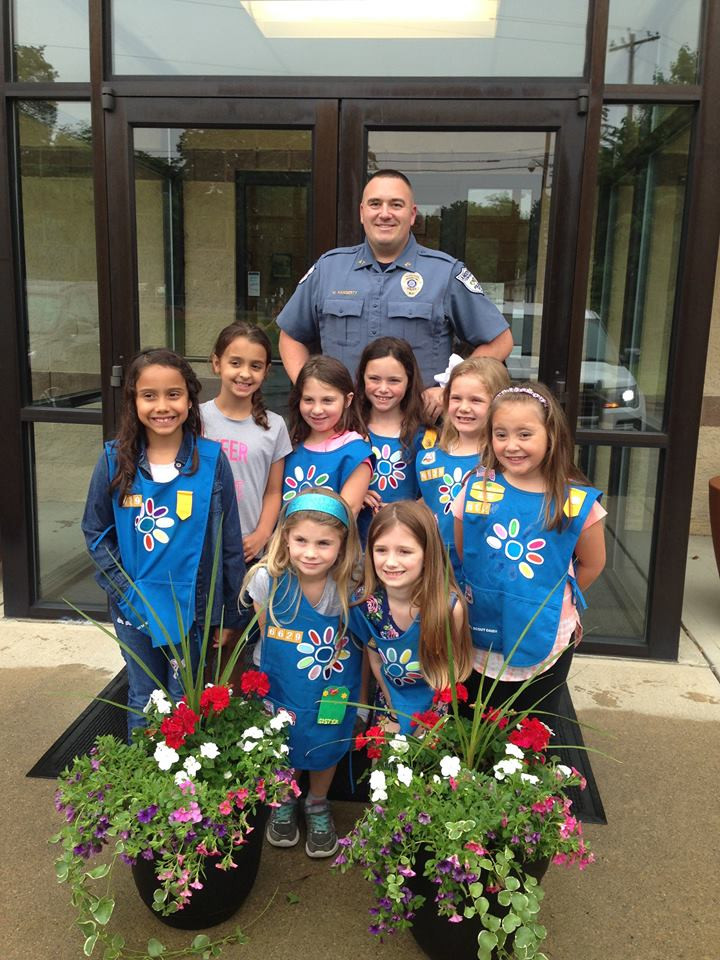 Daisy Troop 6629 of Andover Township came to the Andover Township Police Department to deliver flowers. The Daisies wanted to do something for the police department while also offering the public a chance to see the beautiful flowers. Officer Michael Haggerty was on hand to receive the generous gift from Daisy Troop 6629.