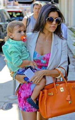 Kloe Kardashian Bikrin orange.jpg