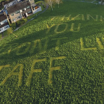 """""""Thank You Front Line Staff"""" Mowed Into Grass"""