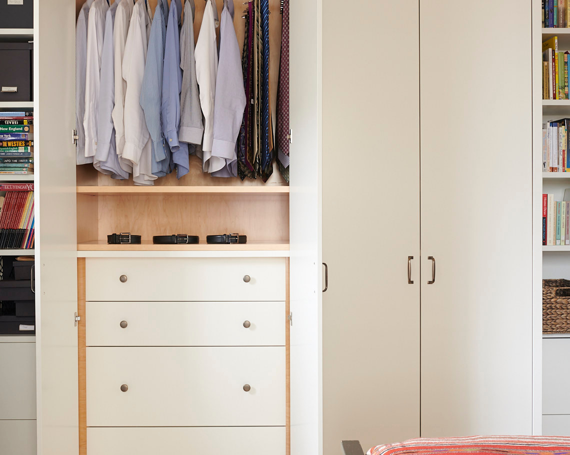 ...housing built-in dresser drawers and hanging space