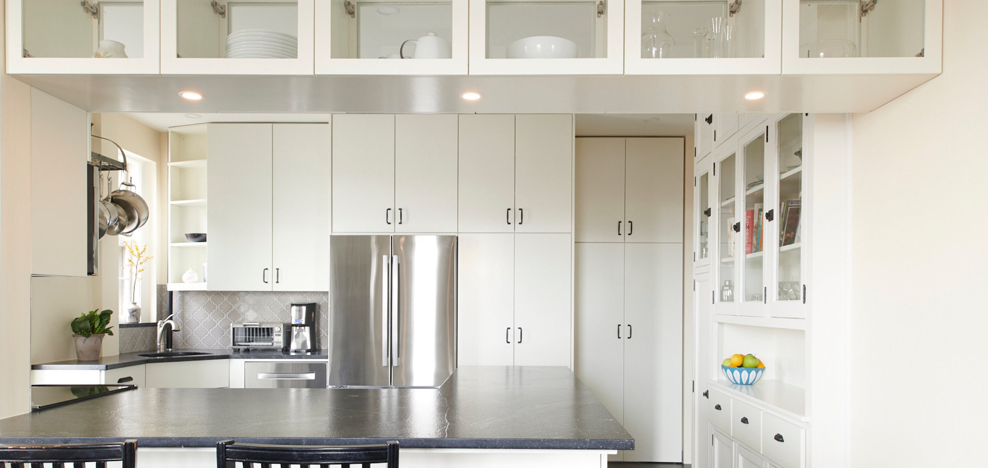 A nice big pass through cut-out of the wall between the kitchen and dining room with glass door cabinets for displayable dishware