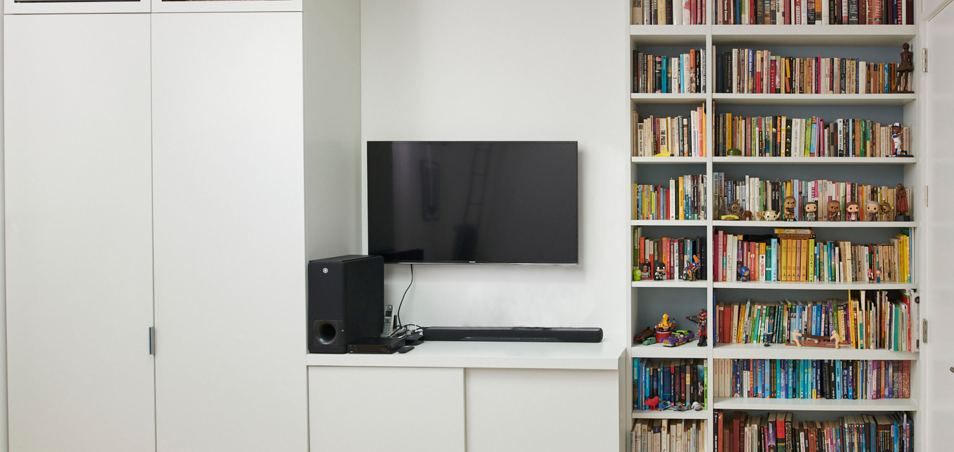 A simple straightforward living room / den unit optimizing storage.