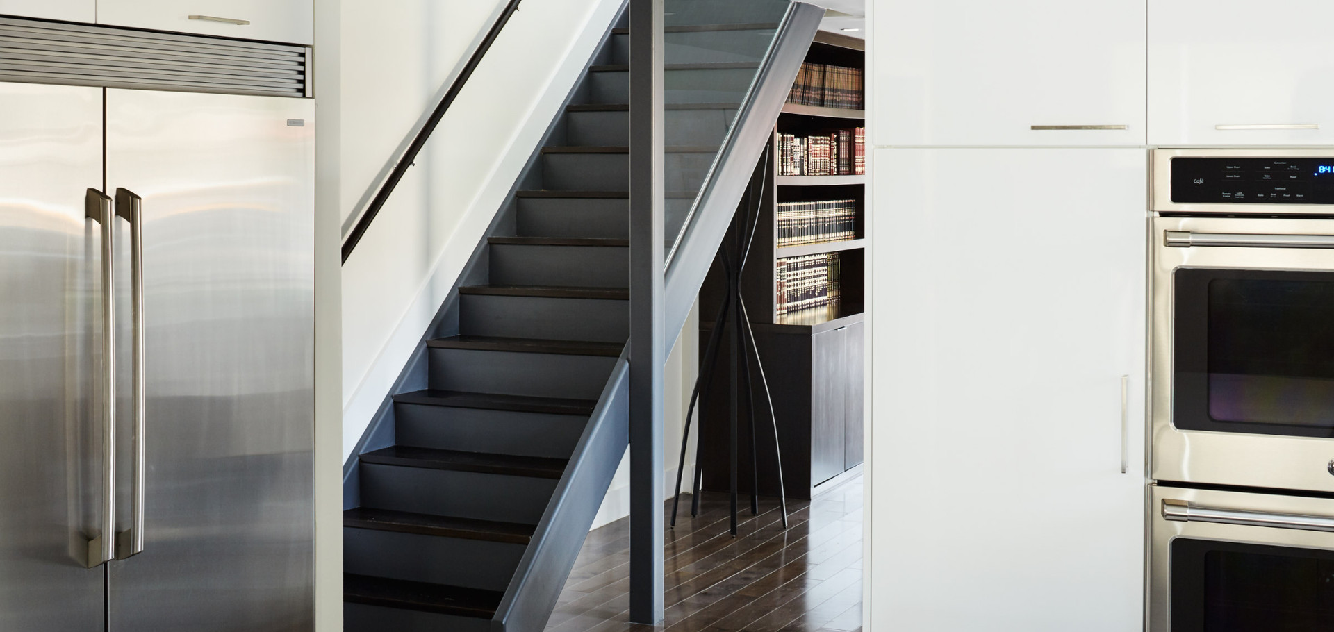 Blackened walnut stair treads add a nice touch to this steel stair  photo by Dylan Chandler coutesy of M Monroe Design