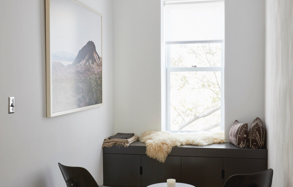 A low cabinet makes for a comfy window seat