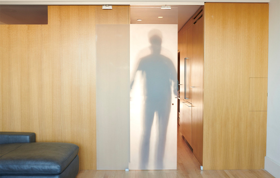A frosted sliding glass panel can close off the living room if need be