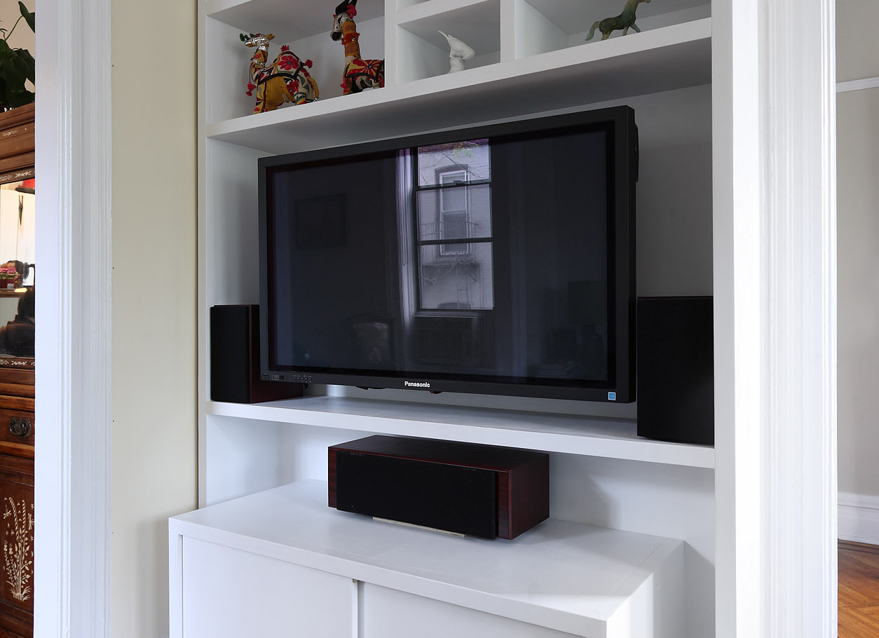 This entertainment cabinet has an unusual telescoping design and open shelf spacing...