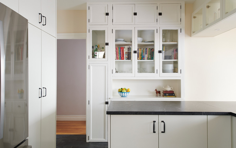 Tasteful inclusion of the original butler's pantry into the kitchen layout allows for the existing details of the apartment to feel contemporary.