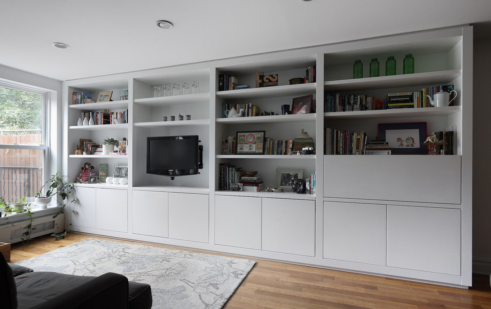 This 16 foot wide modern wall unit adds lots of function as well as beauty to a light filled Prospect Heights apartment