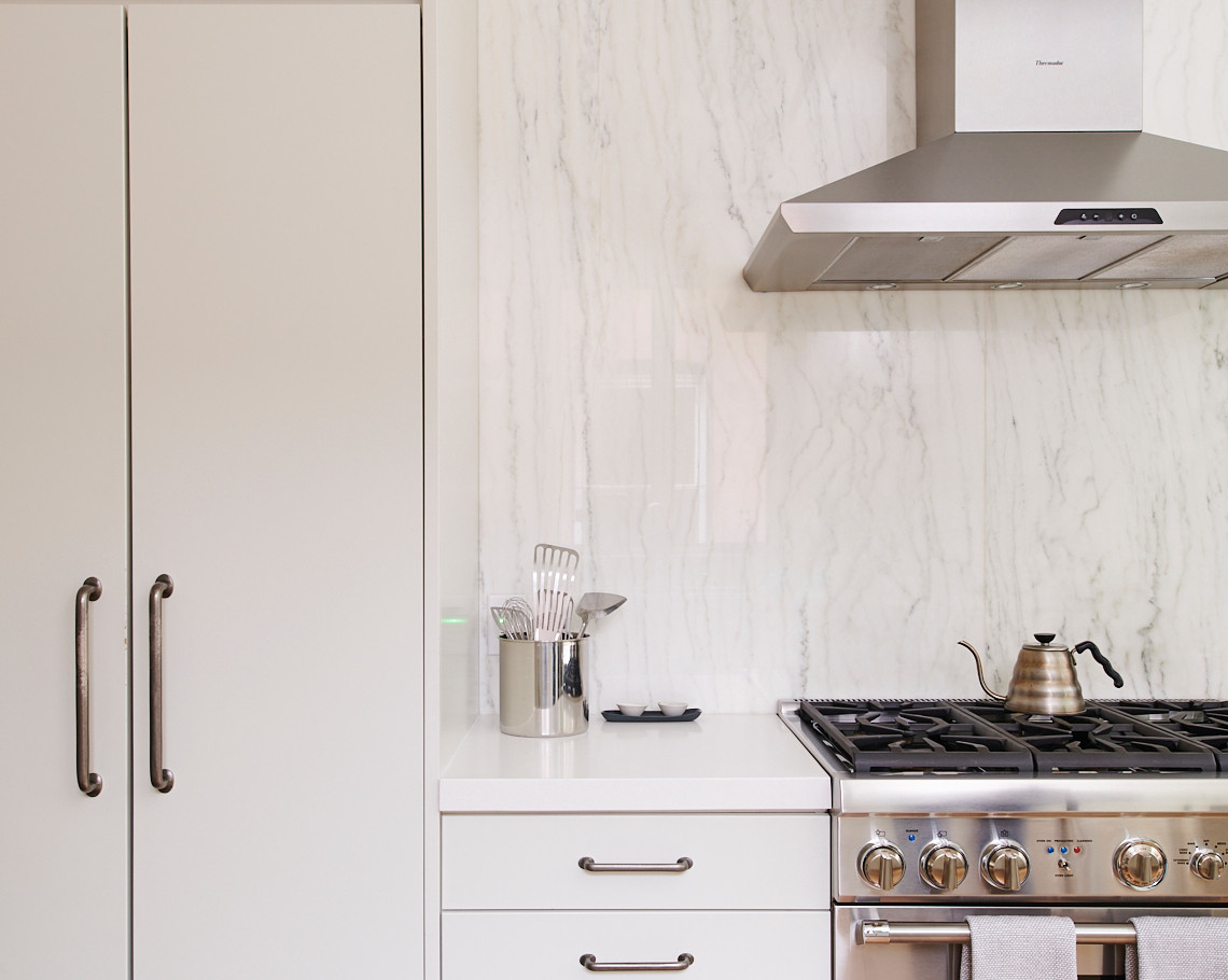 Many different storage solutions are tucked away neatly behind the flush drawer fronts and doors