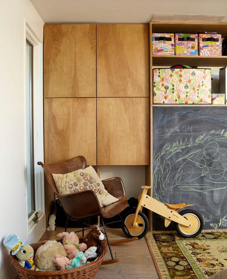 Natural birch cabinet doors warm up this kid playroom