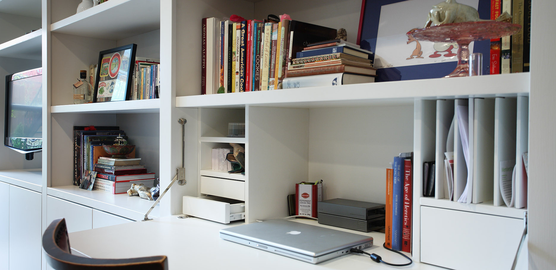 The desk flap folds down to reveal a custom office space that can be neatly tucked away behind it's door when not in use