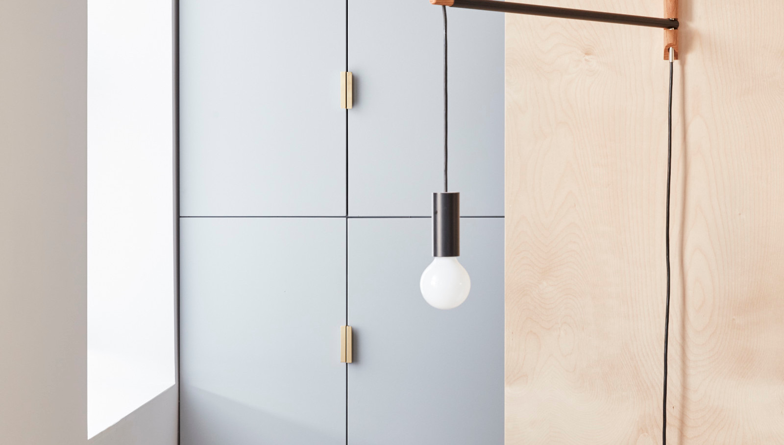 Brass pulls add character to this walk in closet area