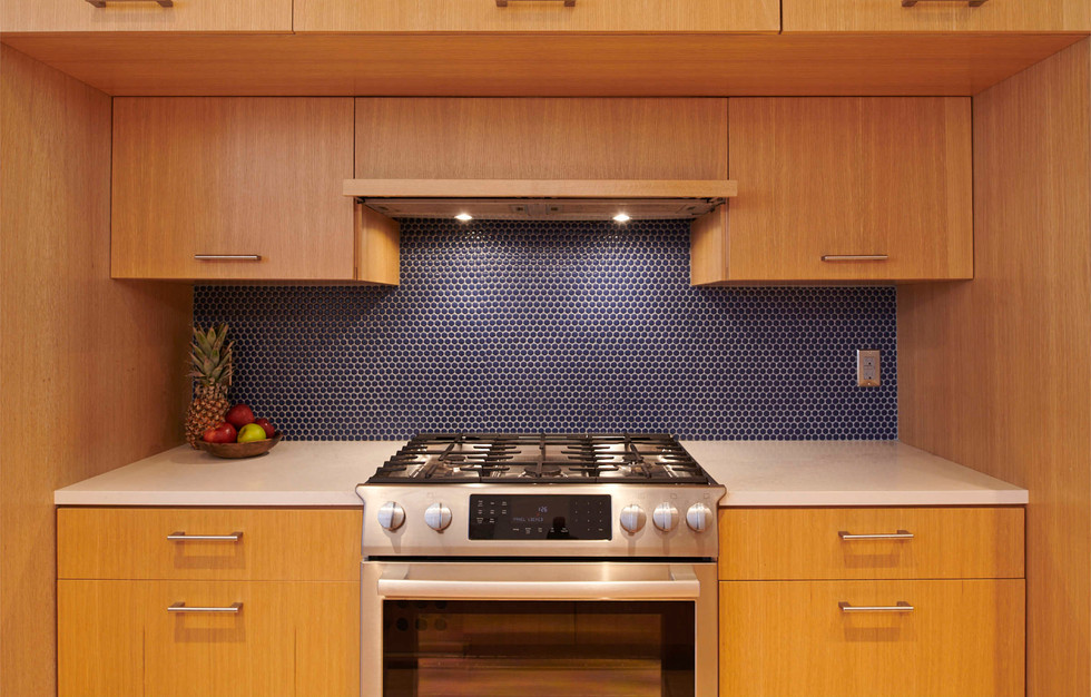 The stove and adjacent cabinets are set back to allow more room for cooking