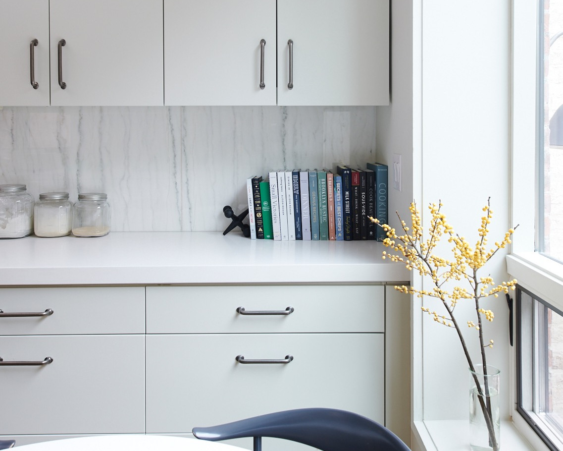 The clean, modern cabinets and counters are further enhanced by lots of natural light