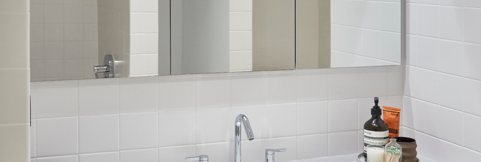 'Knife edge' angled doors allow for handle-less opening of this vanity