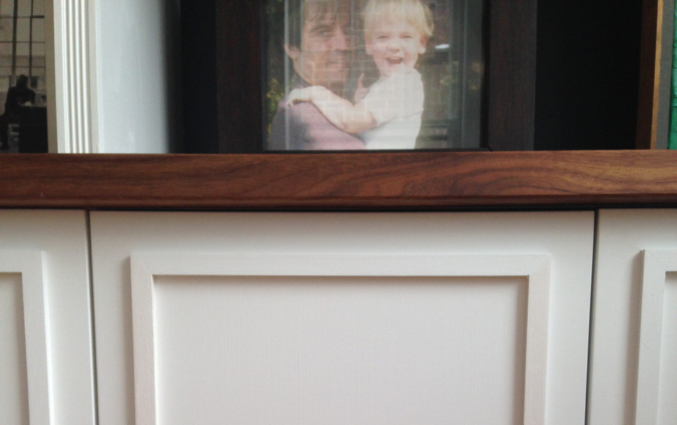 These custom applied moulding cabinet doors add a touch of tradition to a contemporary setting