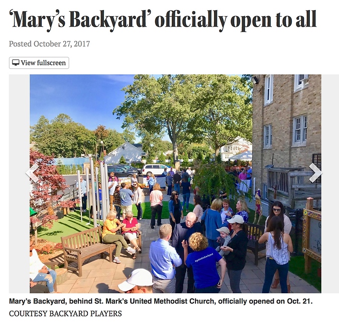 """Headline """"Mary's Backyard officially open to all"""" with several people talking in small groups in an outdoor park."""