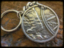 This is the Steadfast Trek Medallion or Key Chain.  Pure, lead-free Pewter.  On the front side is the dusty boot of a pioneer.  On the reverse, a vignette of the First Vision.