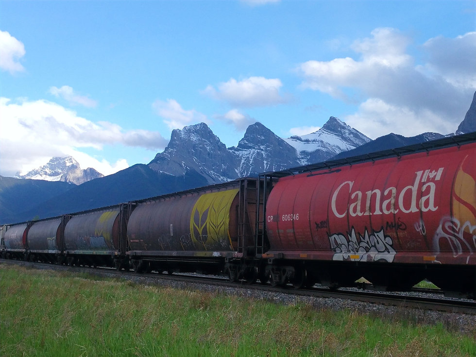 CN train in Canmore looking at the three sister