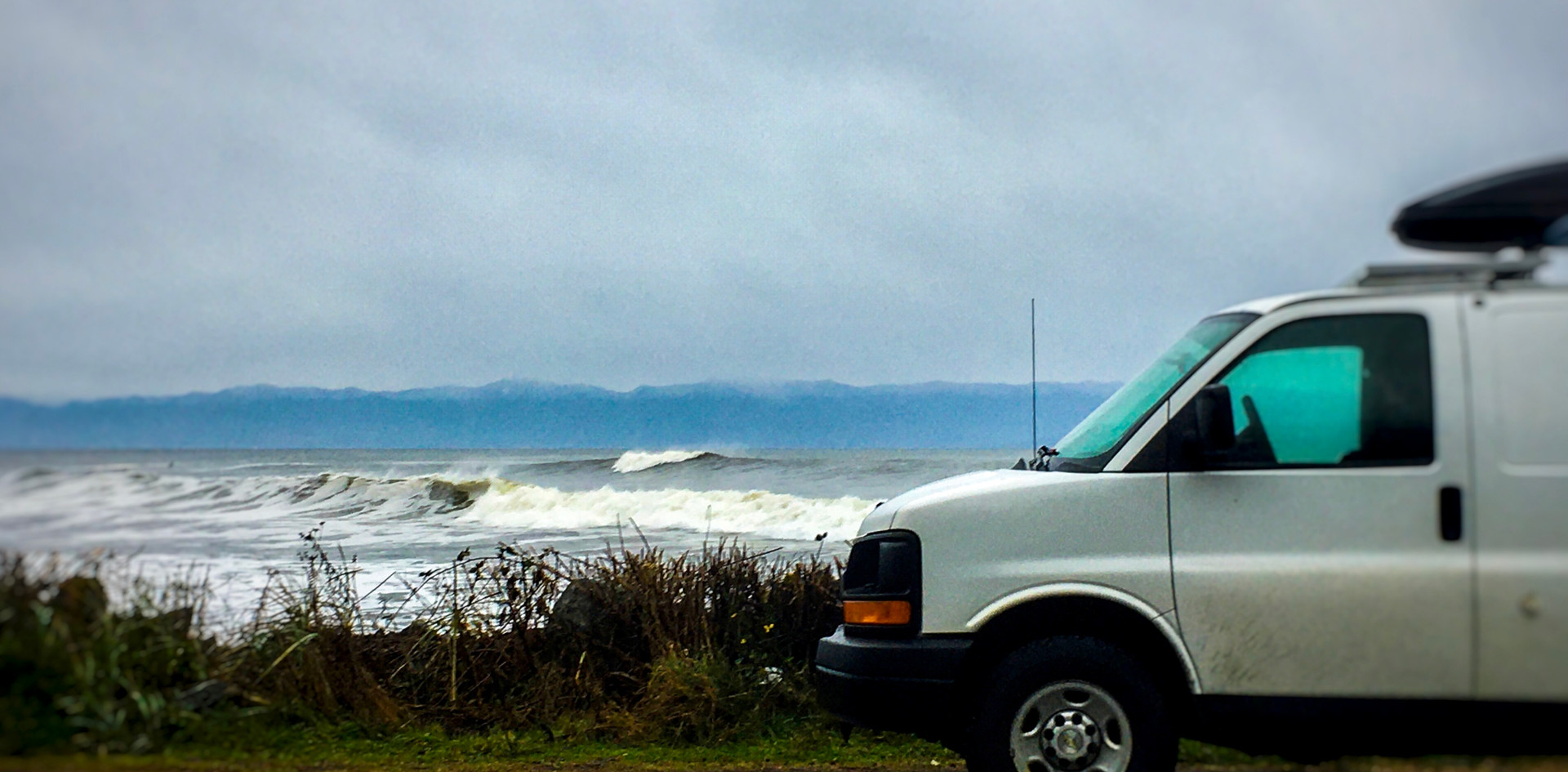 Surfer watching with the campervan